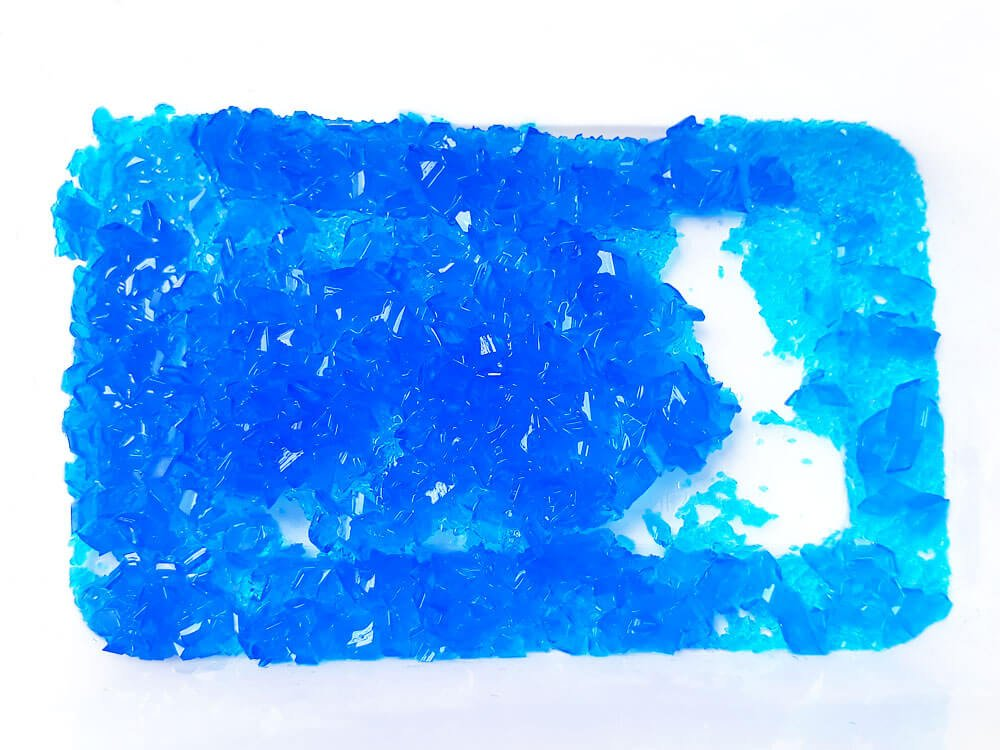 The same copper sulfate crystals after putting the container in a fridge overnight.