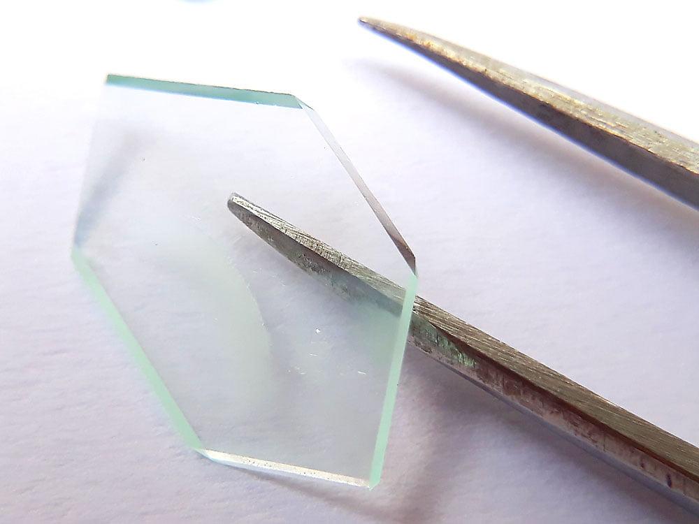 A large, flat crystal of Mohr's salt.