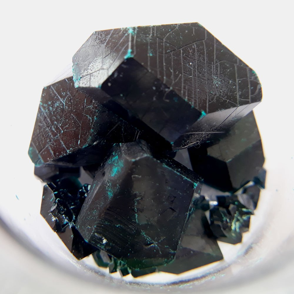 After 11 months, faint blue patches begin to appear on the crystals due to dehydration.
