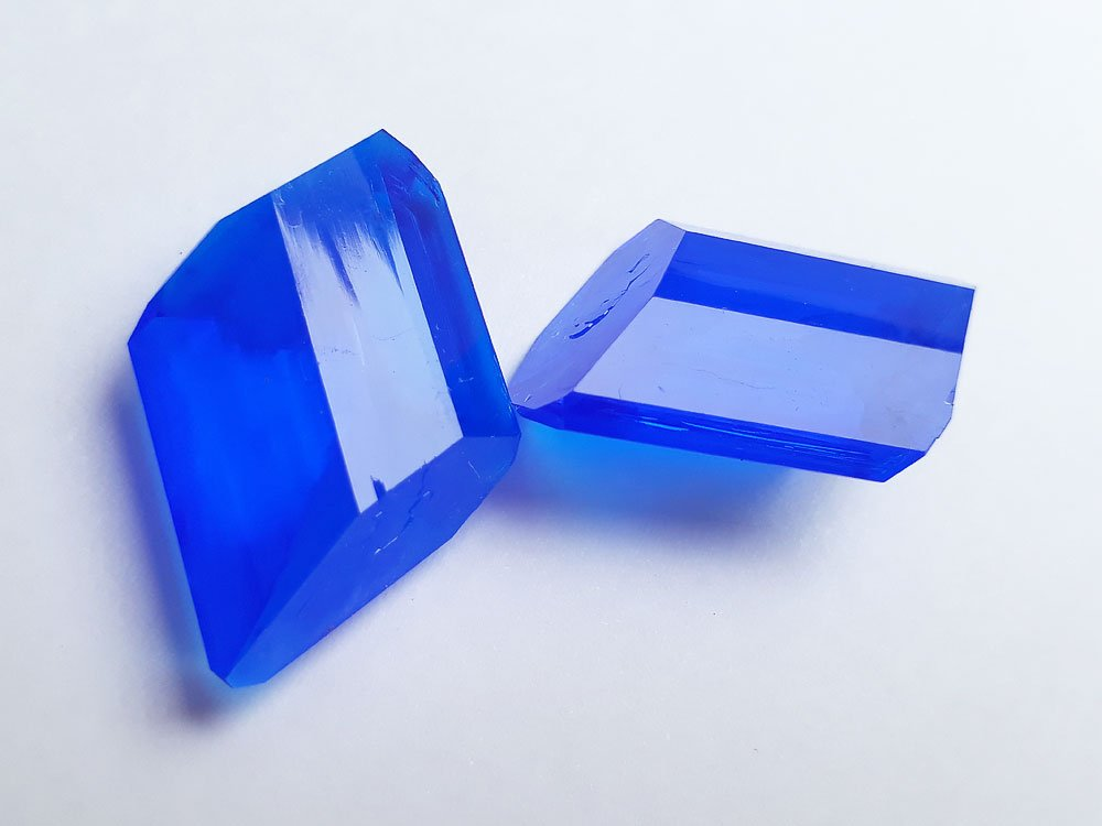 Two copper sulfate crystals