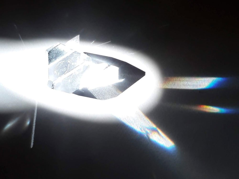 An alum crystal acting as a prism in the morning sun.